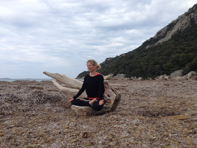 Theresa Moodie Wellness Coach doing Yoga on the beach
